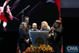 "Alison Krauss (second from right) is joined by (left to right) Suzanne Cox, Barry Bales, Sidney Cox, and Ron Block for a performance of ""Amazing Grace"" during a candlelight vigil Monday at Ascend Amphitheater to honor the victims of the Las Vegas shooting.   Photo Credit: Hunter Berry/CMA"